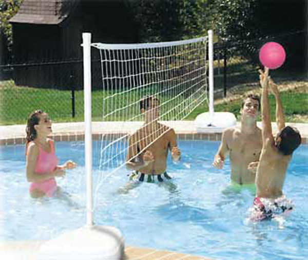 kids playing volleyball in a pool