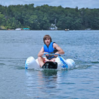 inflatable water ski trainer with human positioned on it